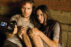 "Michael Stahl-David and Odette Yustman in ""Cloverfield."""