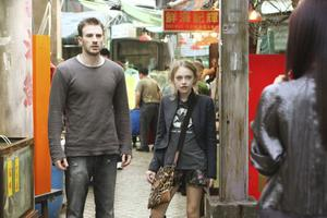 "Chris Evans as Nick Gant and Dakota Fanning as Cassie Holmes in ""Push."""