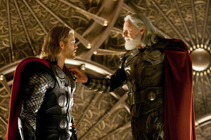 "Chris Hemsworth as Thor and Anthony Hopkins as Odin in ""Thor."""