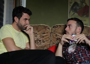 "Tom Cullen as Russel and Chris New as Glen in ""Weekend."""