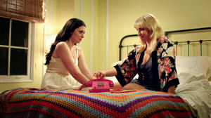 "Lauren Miller as Lauren and Ari Graynor as Katie in ""For a Good Time, Call."""