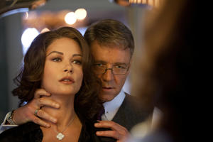 "Catherine Zeta-Jones and Russell Crowe in ""Broken City."""