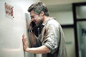 "Richard (Brad Pitt) cries into the hospital phone as he speaks to his son in ""Babel."""
