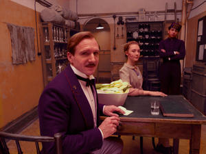 """Ralph Fiennes as M. Gustave, Saoirse Ronan as Agatha and Tony Revolori as Zero in """"The Grand Budapest Hotel."""""""