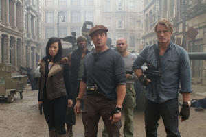 "Yu Nan as Maggie, Sylvester Stallone as Barney Ross, Dolph Lundgren as Gunner Jensen, Terry Crews as Hale Caesar and Randy Couture as Toll Road in ""The Expendables 2."""