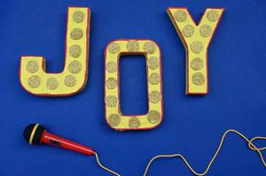 DIY: Celebrate 'Sing' with This Sparkling Sign