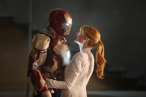 "Robert Downey, Jr. as Iron Man and Gwyneth Paltrow as Pepper Potts in ""Iron Man 3."""