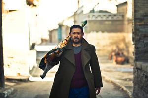 """Jiang Wu as Dahai in """"A Touch of Sin."""""""