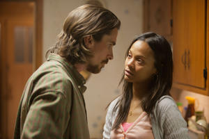"Christian Bale and Zoe Saldana in ""Out of the Furnace."""