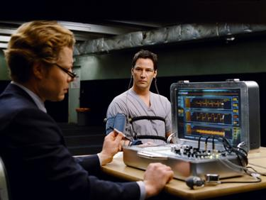 "Keanu Reeves as Klaatu and David Richmond-Peck as polygraph operator in ""The Day the Earth Stood Still."""