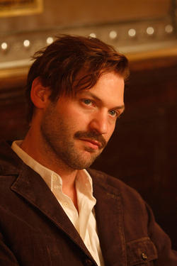 "Corey Stoll as Ernest Hemingway in ""Midnight in Paris."""