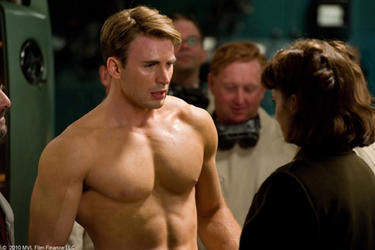 "Chris Evans as Steve Rogers and Hayley Atwell as Peggy Carter in ""Captain America: The First Avenger."""