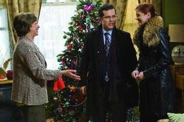"John Leguizamo, Elizabeth Pena and Debra Messing in ""Nothing Like the Holidays."""