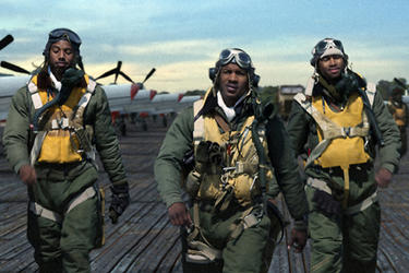 Michael B. Jordan as Maurice 'Bumps' Wilson, Nate Parker as Marty 'Easy' Julian and Kevin Phillips as Leon 'Neon' Edwards in ``Red Tails.''
