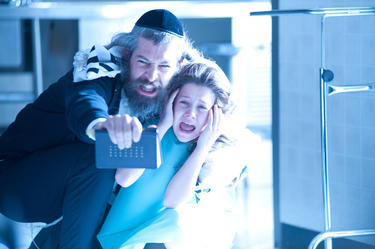 "Matisyahu as Tzadok and Natasha Calis as Em in ""The Possession."""
