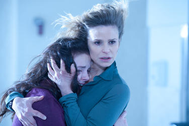 "Madison Davenport as Hannah and Kyra Sedgwick as Stephanie in ""The Possession."""