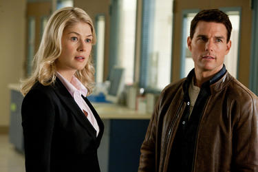 "Rosamund Pike as Helen and Tom Cruise as Reacher in ""Jack Reacher."""