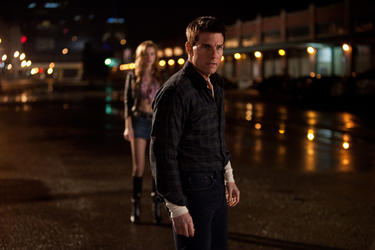 "Alexia Fast as Sandy and Tom Cruise as Reacher in ""Jack Reacher."""