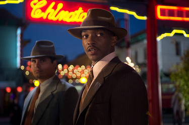 "Michael Pena as Navidad Ramirez and Anthony Mackie as Coleman Harris in ""Gangster Squad."""