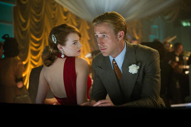 "Emma Stone as Grace Faraday and Ryan Gosling as Sgt. Jerry Wooter in ""Gangster Squad."""