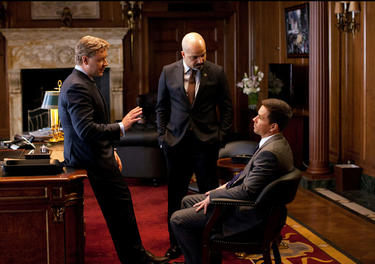 "Russell Crowe as Mayor Hostetler, Jeffrey Wright as Commissioner Fairbanks and Mark Wahlberg as Billy Taggart in ""Broken City."""