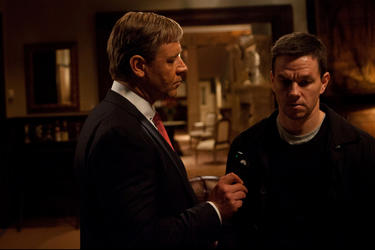 "Russell Crowe as Mayor Hostetler and Mark Wahlberg as Billy Taggart in ""Broken City."""
