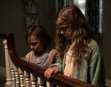 "Isabelle Nelisse and Megan Charpentier in ""Mama."""