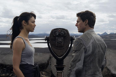 "Olga Kurylenko and Tom Cruise in ""Oblivion: The IMAX Experience."""