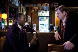 "Don Cheadle as Wendell Everett and Brendan Gleeson as Sergeant Gerry Boyle in ""The Guard."""