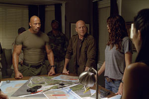 Dwayne Johnson as Roadblock and Bruce Willis as Colton in ``G.I. Joe: Retaliation.&#39;&#39;