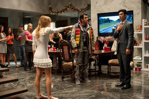 Jordan Hinson as Mary, Kal Penn as Kumar and John Cho as Harold in &quot;A Very Harold &amp; Kumar Christmas.&quot;