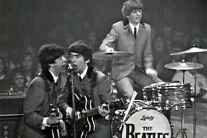 "The Beatles on stage in ""The Beatles: The Lost Concert."""