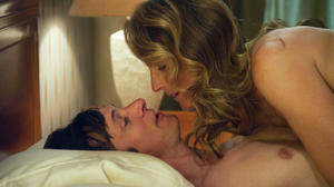 "John Hawkes as Mark O'Brien and Helen Hunt as Cheryl Cohen Greene in ""The Sessions."""