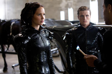 Jennifer Lawrence as Katniss Everdeen, Josh Hutcherson as Peeta Mellark and Lenny Kravitz as Cinna in ``The Hunger Games.&#39;&#39;