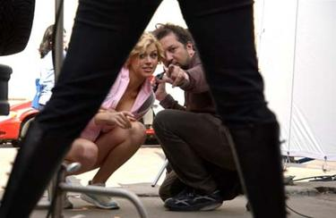 "Adrianne Palicki and director Sebastian Gutierrez on the set of ""Women in Trouble."""
