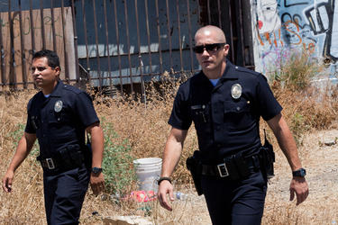 Michael Pena and Jake Gyllenhaal in &quot;End of Watch.&quot;