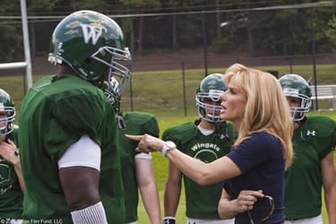 "Quinton Aaron as Michael Oher and Sandra Bullock as Leigh Anne Tuohy in ""The Blind Side."""
