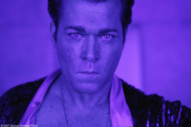 "Ray Liotta as Dorothy Macha in ""Revolver."""