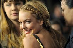"FILE - This April 11, 2013 file photo shows actress Lindsay Lohan, a cast member in ""Scary Movie V,"" at the premiere of the film in Los Angeles. Lohan's lawyer Mark Jay Heller told a judge at a May 2, 2013 hearing that Lohan had checked into a rehab facility per a judge's orders. (Photo by Chris Pizzello/Invision/AP, file)"