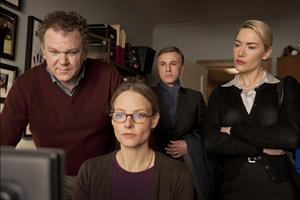 "John C. Reilly as Michael Longstreet, Jodie Foster as Penelope Longstreet, Christoph Waltz as Alan Cowan and Kate Winslet as Nancy Cowan in ""Carnage.''"