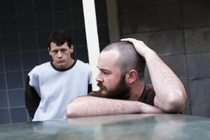 Lucas Pittaway as Jamie Vlassakis and Daniel Henshall as John Bunting in ``Snowtown.''