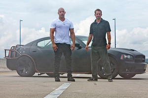 "Vin Diesel and Paul Walker in ""Fast Five."""