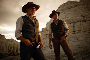 "Harrison Ford and Daniel Craig in ""Cowboys & Aliens."""