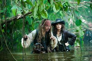 "Johnny Depp as Captain Jack Sparrow and Penelope Cruz as Angelica in ""Pirates of the Caribbean: On Stranger Tides."""