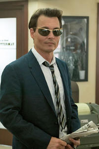 "Johnny Depp as Paul Kemp in ""The Rum Diary."""