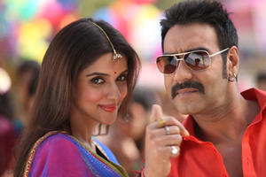 "Asin Thottumkal as Sania Ali and Ajay Devgn as Prithviraj Raghuvanshi in ""Bol Bachchan."""