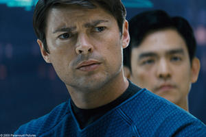"Karl Urban as Dr. McCoy and John Cho as Sulu in ""Star Trek."""