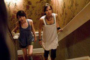 "Emily Browning as Anna and Arielle Kebbel as Alex in ""The Uninvited."""