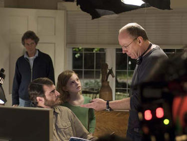 "Joaquin Phoenix, Elle Fanning and director Terry George on the set of ""Reservation Road."""