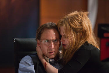 Nicolas Cage as Kyle and Nicole Kidman as Sarah in ``Trespass.''